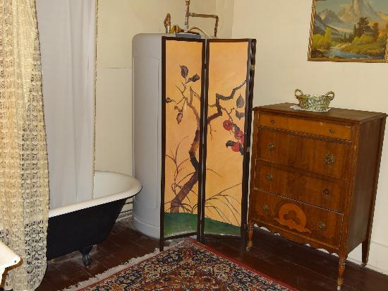 Historic Western Hotel: shared antique bathroom with ball and claw foot tub