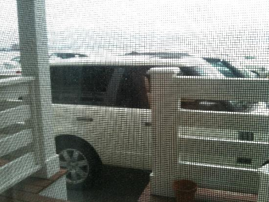 Anchor Inn: View from inside the room - you can maybe see the harbour over the car???