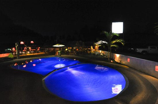 Kob Thai Restaurant : night time , our colourful swimming pool , and salas ( isolated tables)
