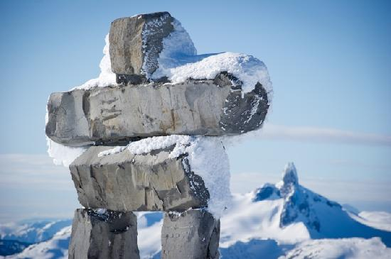 Inukshuk on the Peak on Whistler Mountain with Black Tusk in the background. Photo credit: Mike