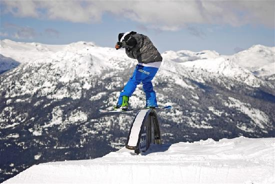 Whistler, Canada: Snowboarder on Rail in the Nintendo Terrain Park on Blackcomb Mountain. Photo credit: Chad Choml