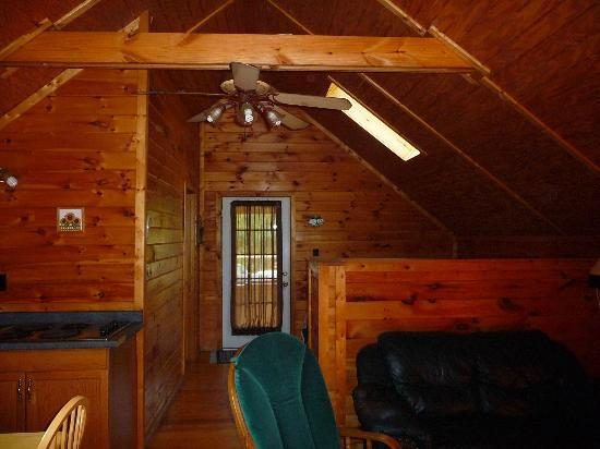 Sunrise Log Cabins: View from living area toward bedroom and deck