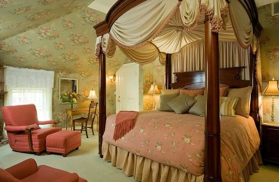Experience romance and luxury in room 12 at Berry Manor Inn!