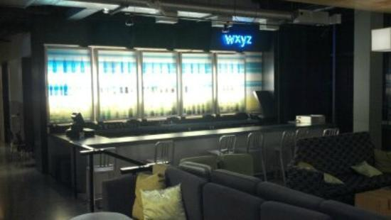 Aloft - Baltimore Washington International Airport: Bright backlit bar