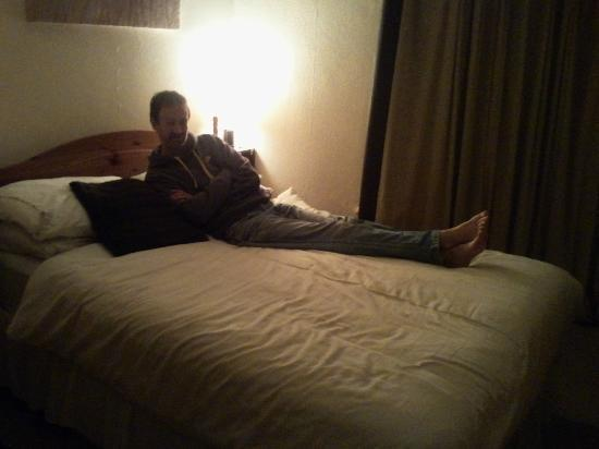 The Merginn: our family room (my partner relaxing on the double bed in our room)