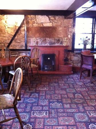 The Lagg Hotel: cosy dining area with a fireplace