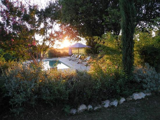 Lagnes, : Late summer evening sun over the pool