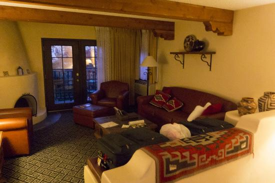 Inn of the Governors: The sitting room portion of our suite, complete w/ Kiva fireplace