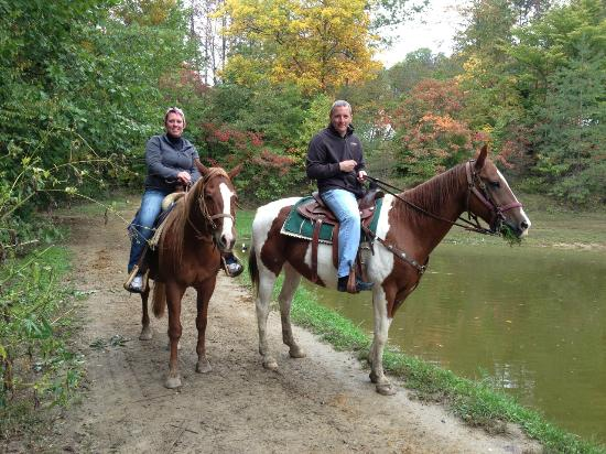 Rawhide Ranch: At the end of our trail ride, Gill offered to take a pretty pic of us by the pond.