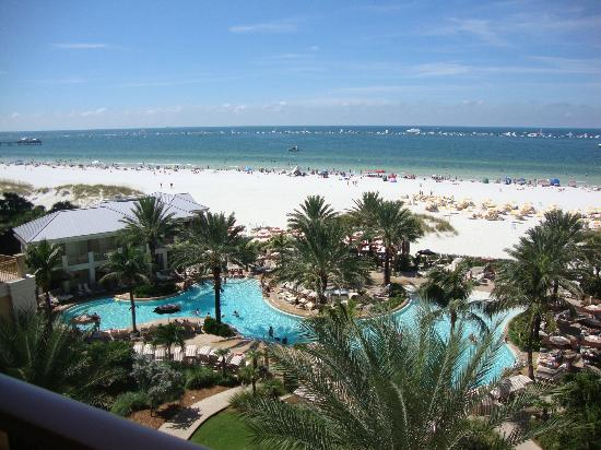 Sandpearl Resort: View of the pool area and beach from the balcongy