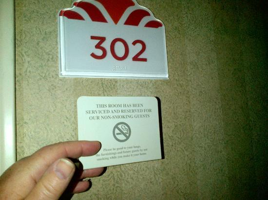 "Hawthorn Suites by Wyndham Cincinnati: My room number, with the ""nonsmoking"" placard found inside the room"