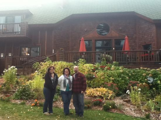 Cornucopia, WI: Us in front of the beautiful flower garden!!
