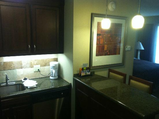 Staybridge Suites Columbia: facing kitchen/bar area.  Fridge is to the left.
