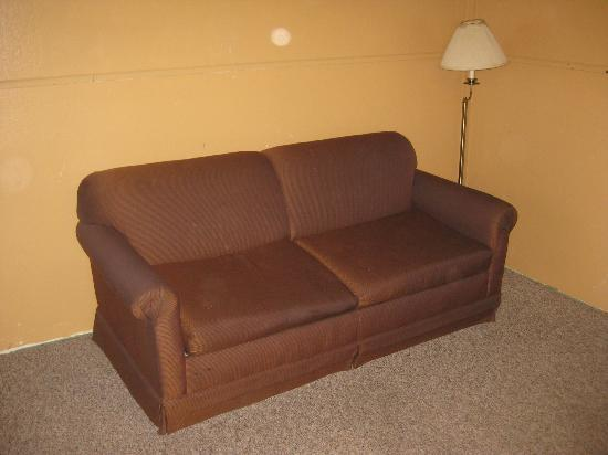 "Yankee Village Motel: Our ""suite"" with a stained couch"