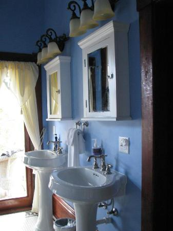 The Inn at 909 Lincoln: His & hers sinks, plus door to private balcony