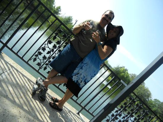 The Villa at Messina Hof: My husband and I in front of turtle pond and waterfall