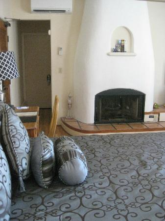 The Eagle Inn: Adobe style fireplace in our room