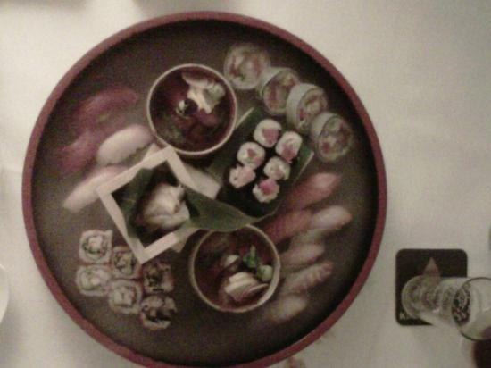 sushi, sashimi and rolls served in a dry ice smoking tray - Picture of ...