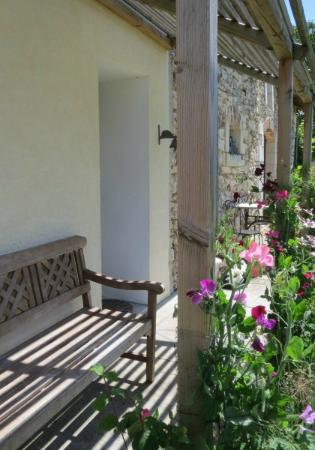 Le Grand-Pressigny, France: Noix, quiet shady spot outside the front door facing into the sunny courtyard garden