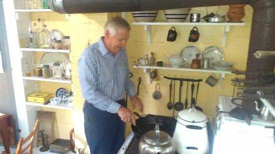 The Grove -- The Inn on Harlee: Denley demonstrating cooking with a wood-fired stove.