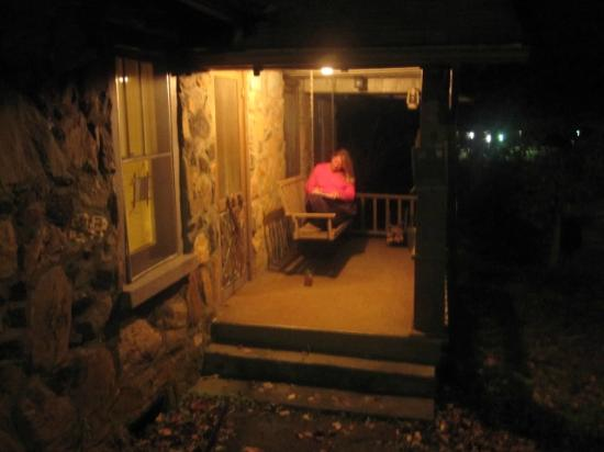 Mountain Brook Cottages: Night view of the porch &amp; swing