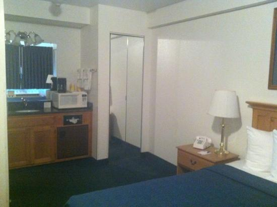 Quality Inn Central: closet, fridge, microwave, updated vanity and sink area. also has a hair dryer. very clean.