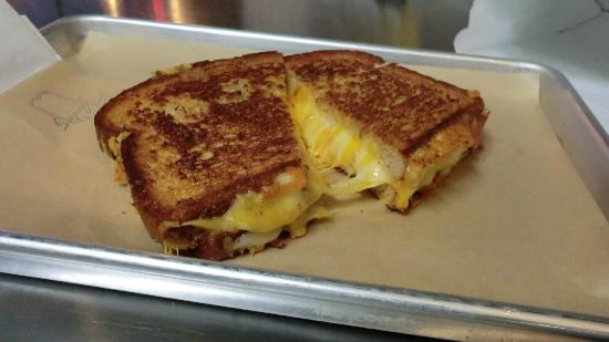 Meltz Extreme Grilled Cheese: The American Ooze - Orange and White American, Sharp Cheddar, Colby Jack, Swiss and Cheese Wiz