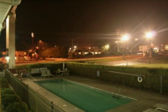 Days Inn Dalton: Standing on 2nd floor exterior corridor, a view of pool / road.