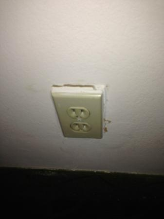 Quality Suites: power socket falling out of the wall awaiting a small child