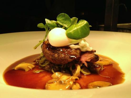 ... of pigeon, bacon and leek lentils, poached quail's egg, mushroom jus