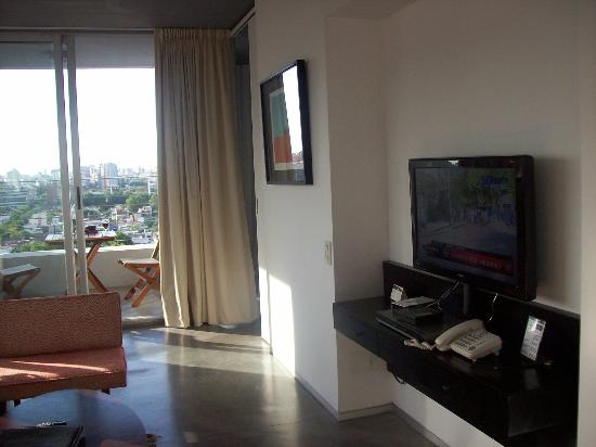 Hollywood Suites & Lofts: Comedor, equipado con aire, tv