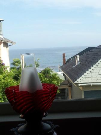 Martine Inn: View standing at our window for partial ocean view. This view could not be seen from the bed or