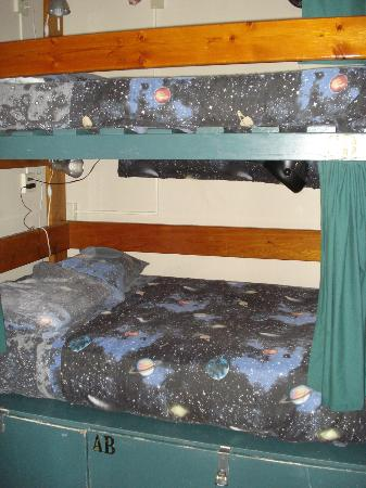 The Green Tortoise Hostel: Queen dorm bed with privacy screen, personal reading light & fan