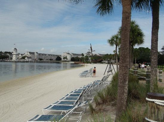 Disney's Beach Club Villas: our hotel beach with pool in background by the ship