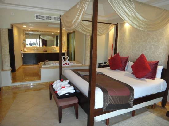 Majestic Elegance Punta Cana: Bed with a view of the sink area and indoor jacuzzi