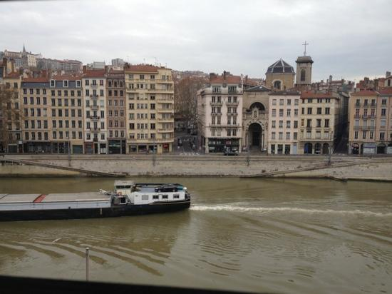Le Phenix Hotel: from 4th floor window of Saone and boat