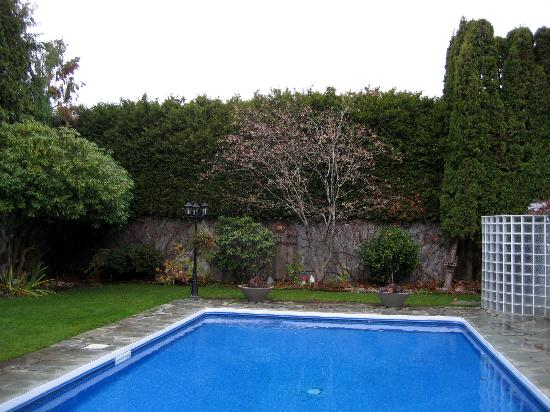 Backyard pool area picture of the stone hedge bed and for Richmond gardens pool