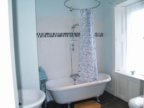 en suite with roll top bath and overhead shower picture