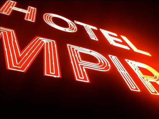 Empire Hotel: Sign from rooftop bar.