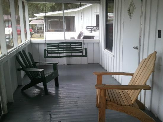 Shell Island Fish Camp: The front porch, view two. The swing was so nice!