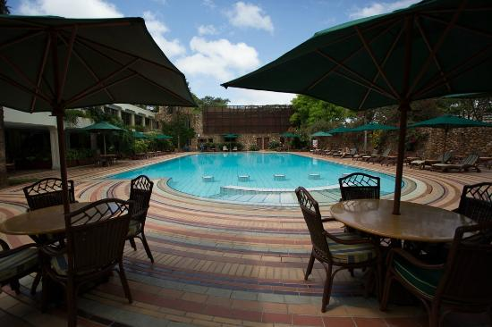 Pool and outdoor restaurant seating picture of nairobi for Pool garden restaurant nairobi
