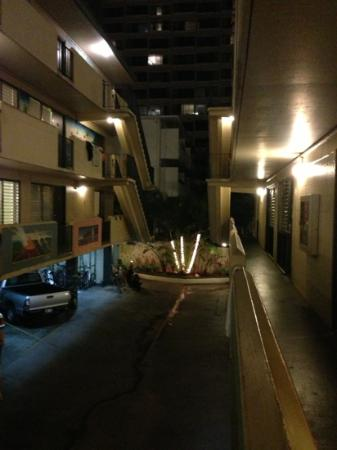 Waikiki Beachside Hostel: The hostel at night. Open air halls, how cool is that?!