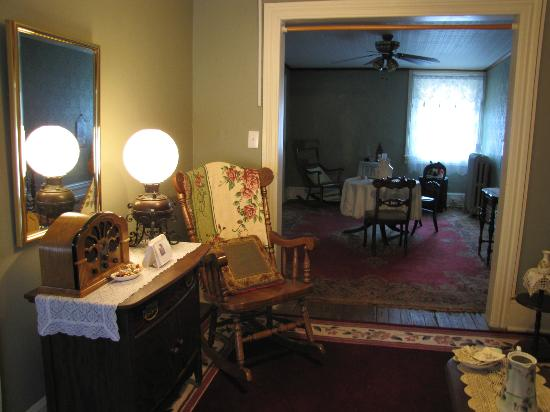 Maid's Quarters Bed, Breakfast & Tearoom: Rocking chair, radio, and shot of dining room