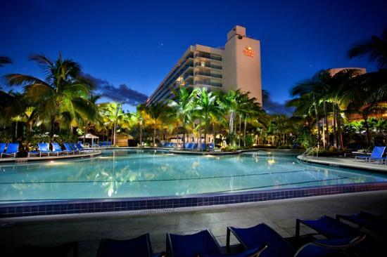 Crowne Plaza Hollywood Beach: View of hotel from the pool at night