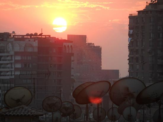 Hilton Zamalek Residence: View of the sunset from our balcony, looking towards Giza City.