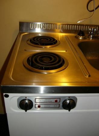 The Discovery Inn: Kitchenette stove. Part of sink/stove/fridge unit.