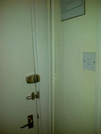 Beaufort Hotel - Chepstow: Exposed piping, poorly fitted locks & doors.