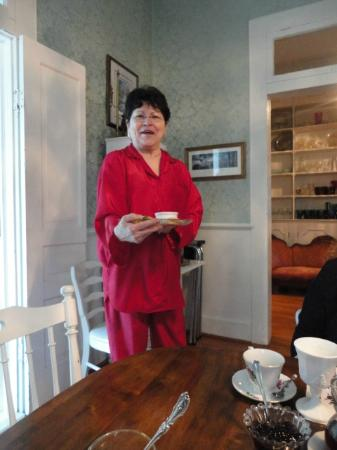 T'Frere's Bed & Breakfast: Maugie in her red silk pajamas serving breakfast