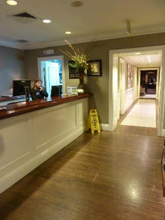 Inn at the Opera: Reception desk and Hallway to dining area