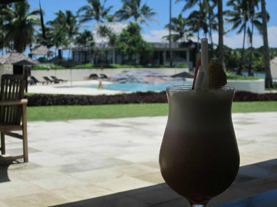 The Pearl South Pacific: Enjoying a cocktail at the Bistro, looking at the pool
